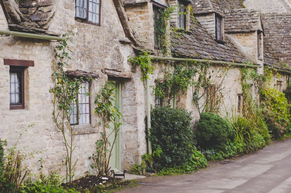 Cotswold Cottage With Trees Growing On It